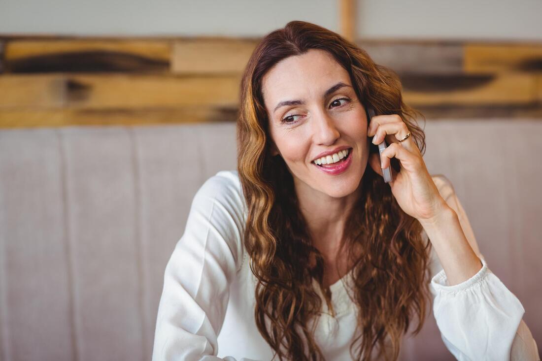 curly hair girl on phone