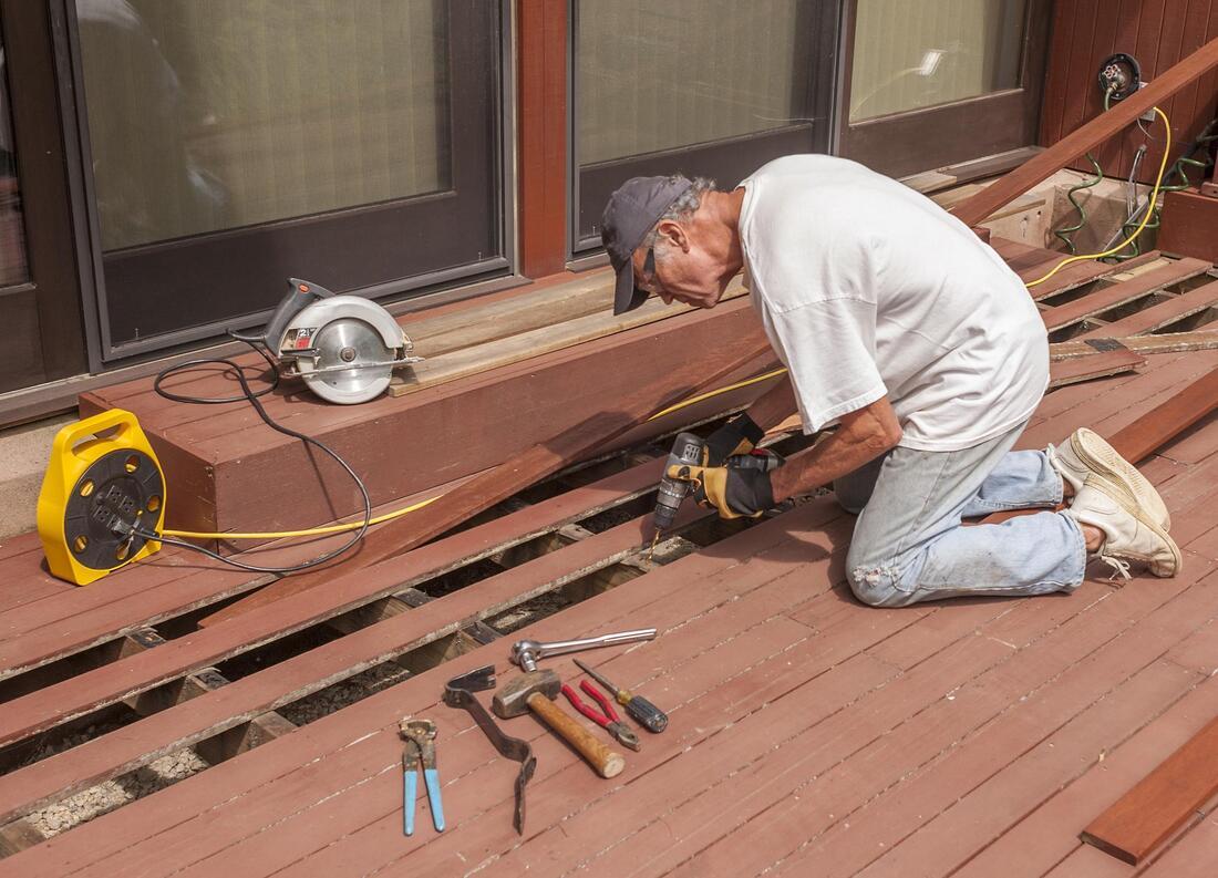 deck contractor repairing deck
