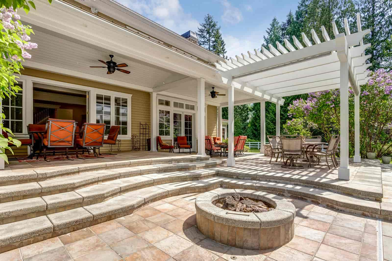outdoor space with new pavers and pergola